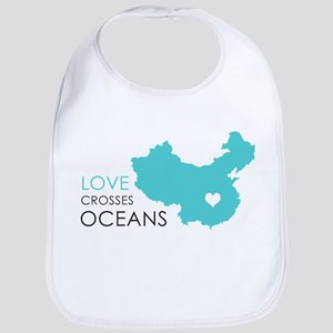 Love Crosses Oceans Bib